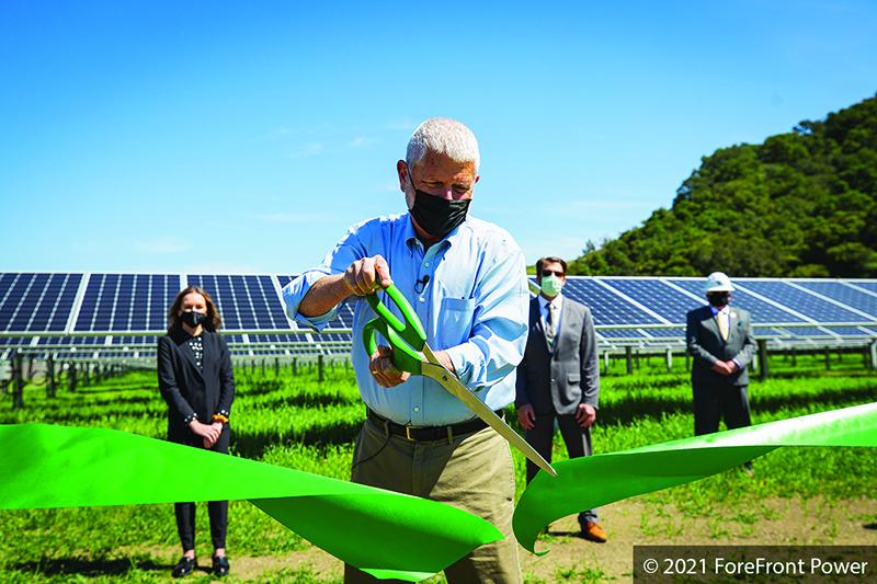 Bruce Gibson, County Supervisor, cuts ribbon at the solar farm